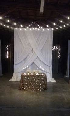 a sweetheart table fit for royalty with stunning draping brought in for the backdrop wedding