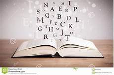 libro lettere d opened book with flying letters stock image image of up