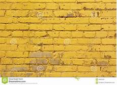 painted yellow brick wall background texture in bright tints image 58993229