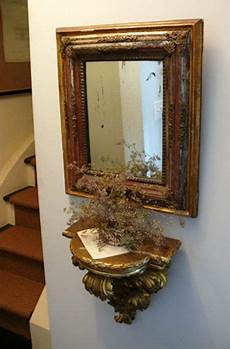 gilded gilt gold mirror vignette shelf wall sconce decorating ideas candle wall