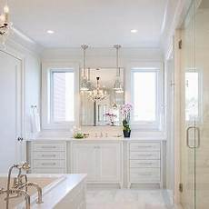 Traditional All White Bathroom Ideas by All White Master Bathroom With Chandelier Tub