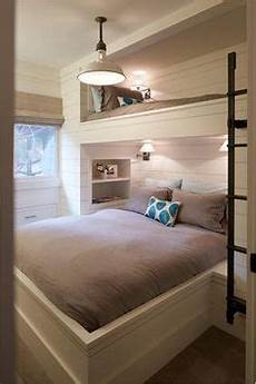 rustic country bunk room features built in barnwood bunk beds dressed in yellow bedding flanking