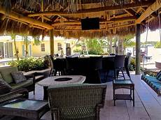 Decorating Ideas For Outdoor Kitchen by Tiki Hut Outdoor Kitchen And Landscaping Tropical