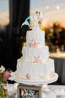 themed wedding cake with mermaid cake topper