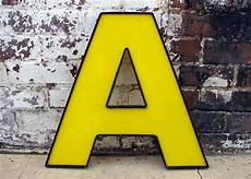 A Retro large reclaimed sign letter a vintage industrial salvage