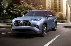 2020 toyota highlander in moon dust driving on city road o