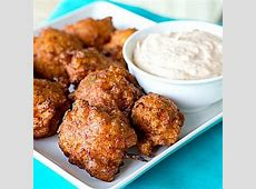 conch fritters with coconut lime curry dipping sauce_image