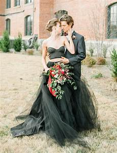 moody autumn wedding inspiration with a black wedding dress green wedding shoes weddings
