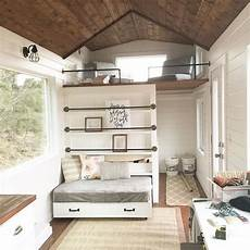 white tiny house loft with bedroom guest bed