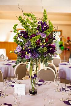 cost of wedding flowers centerpieces purple and green centerpiece this one set in center