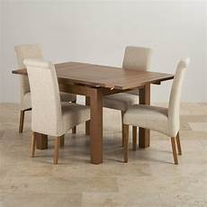 Extending Dining Table In Rustic Oak With 4 Beige Fabric