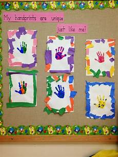 5 hand print activities to do with your 1 year old unique handprints tear construction paper to create frame