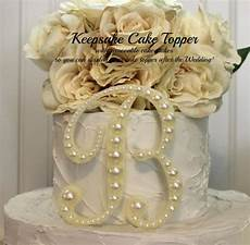 pearl keepsake monogram wedding cake topper decorated with
