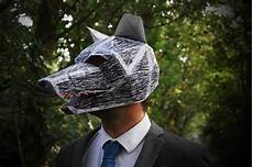 these paper polygon masks are creepy cool amazing