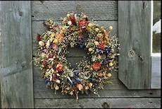 fiori secchi on line a delicate dried flower wreath adorns photograph by bill