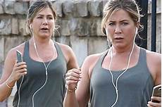aniston works up a sweat as she jogs on set of