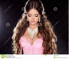 fashion beauty girl with necklace isolated on black background image of hair