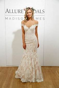 lace off the shoulder form fitting wedding dress with flare at the bottom spring 2018
