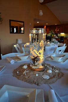 centerpieces for beach themed baby shower with real fish and floating candles beach wedding