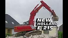 new 215 bagger macht haus platt abbruch