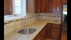 travertine subway tile kitchen backsplash with a mosaic