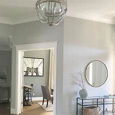 paint color in entry is dolphin fin by behr office is amherst gray by ben moore for the