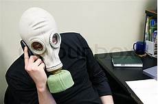 The Person In A Gas Mask Speaks By Stock Photo