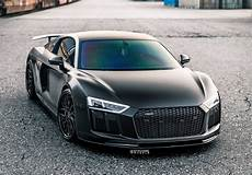 audi r8 v10 plus in all black gives it is an intimidating