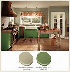 color of the month lucky clover green cabinets accompany green walls in a kitchen