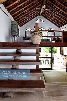 gap interiors wooden staircase to mezzanine floor image no 0057456 photo by costas picadas