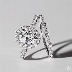 intricate milgrain accent gallery detail oval halo engagement ring styles me2181q and marquise