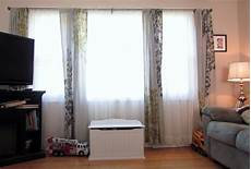 Curtains For Living Room Windows by How To Choose The Right Window Treatments For Wide Windows
