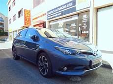 entretien toyota auris hybride toyota auris ii hybride 136h design bleu denim occasion cannes pas cher voiture occasion alpes
