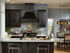 popular paint colors for kitchens with blue wall paint color and dark brown cabinet designed
