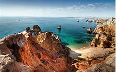 rocks the coast hd sea wallpapers sand ocean sun vacation holiday swimming