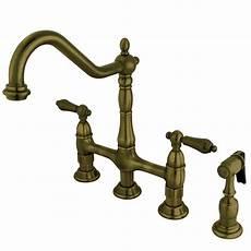 kingston brass kitchen faucet kingston brass cross 2 handle bridge kitchen faucet with side sprayer in vintage brass