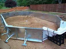 Putting Up Steel Walls On A Swimming Pool