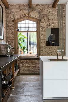 exposed brick two exposed brick walls in a modernized interior decoholic