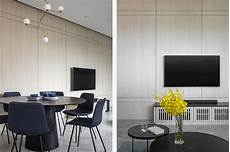 light wood condo dining and tv feature wall by carpenters lookboxliving