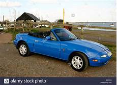 mazda mx5 mk1 2 seater sports car with roof down riverside setting royalty free