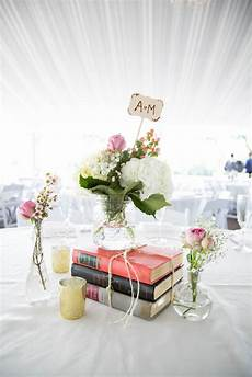 vintage books make a great centerpiece for a book wedding photo by brovado