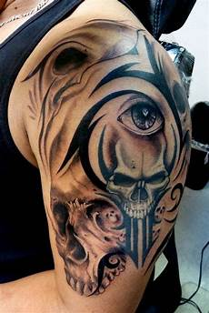 25 cool tribal skull tattoos