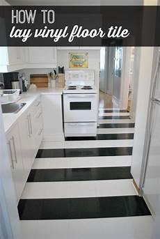 vinyl black and white flooring hometalk how to lay vinyl black and white flooring in stripes