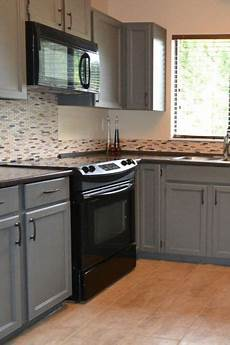 Kitchen Cabinet Colors With Black Appliances by Black Appliances And White Or Gray Cabinets How To Make