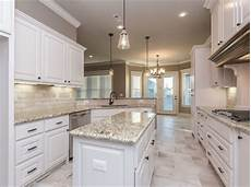 spacious white kitchen with light travertine backsplash and rectangular 12 quot x24 quot floor tiles