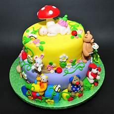 Colorful Fondant Cake With Animals Figurines Stock Image