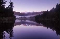 purple nature 4k wallpaper beautiful purple weather landscape of lake matheson hd
