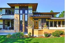 frank lloyd wright inspired house craftsman entry denver by porchfront homes