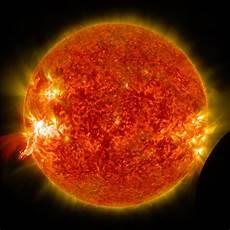 Nasa S Sdo Sees A Solar Flare And A Lunar Transit A
