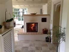 Ofen Für Wohnzimmer - der grundofen als raumteiler mit sitzbank raumteiler in